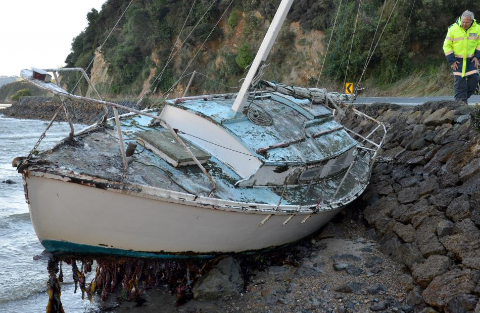 Senior Constable Lox Kellas takes a look at a yacht which broke its moorings and washed into the...