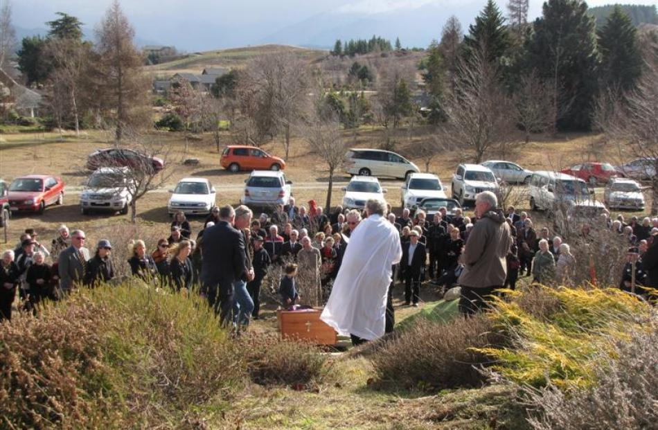 The Roman Catholic Bishop of Dunedin, the Most Rev Colin Campbell, officiates at the burial of...