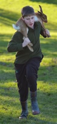 Competing in a hare-carrying contest at the Taieri College Hunting Competition weigh-in at Taieri...