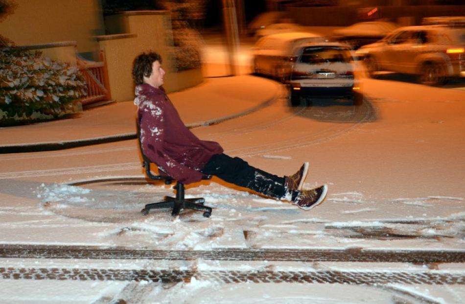 University of Otago student Jack Hunt 'rides' the powder on Pitt St.