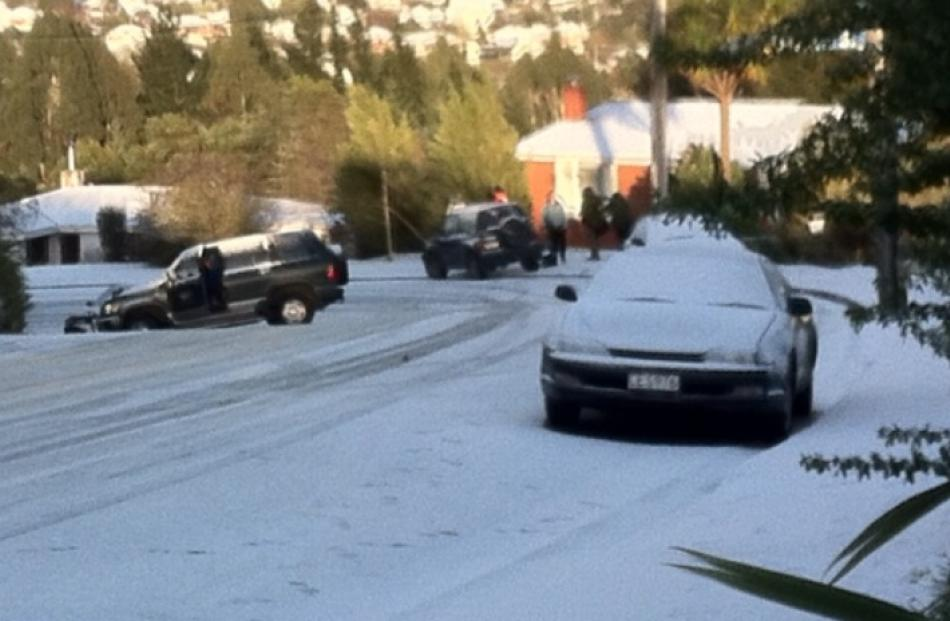 A car leaves a snow-covered Pine Hill Rd. Reader photo by Thim Yee