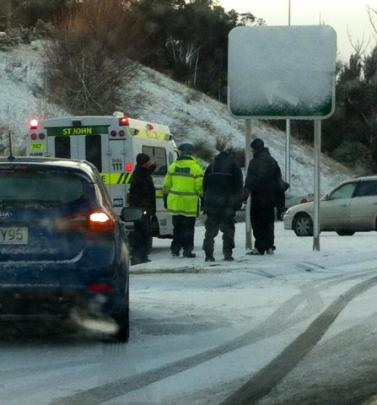 Emergency services at the scene of a crash on Saddle Hill. Photo supplied