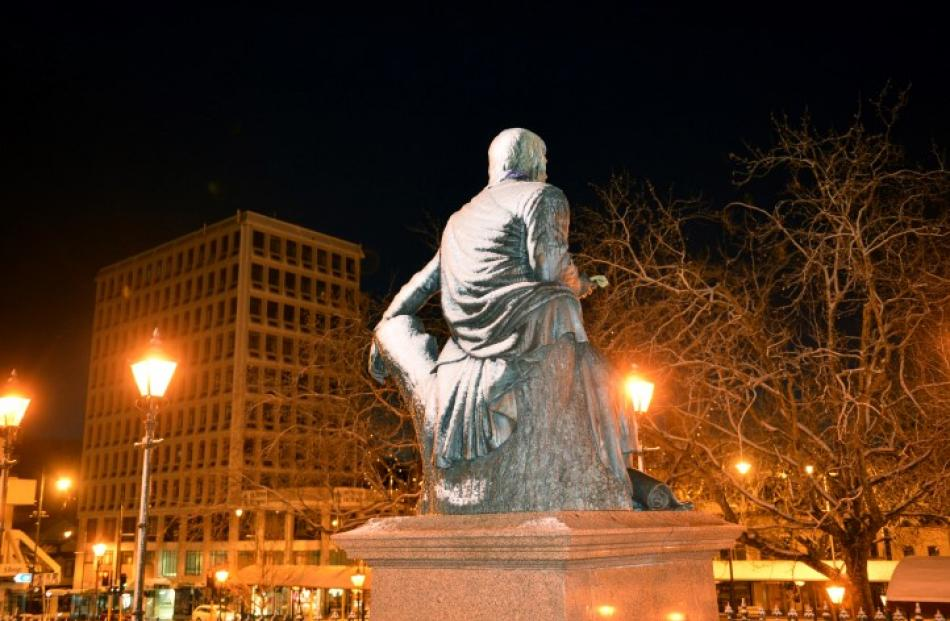 The statue of Robbie Burns wears a mantle of snow.