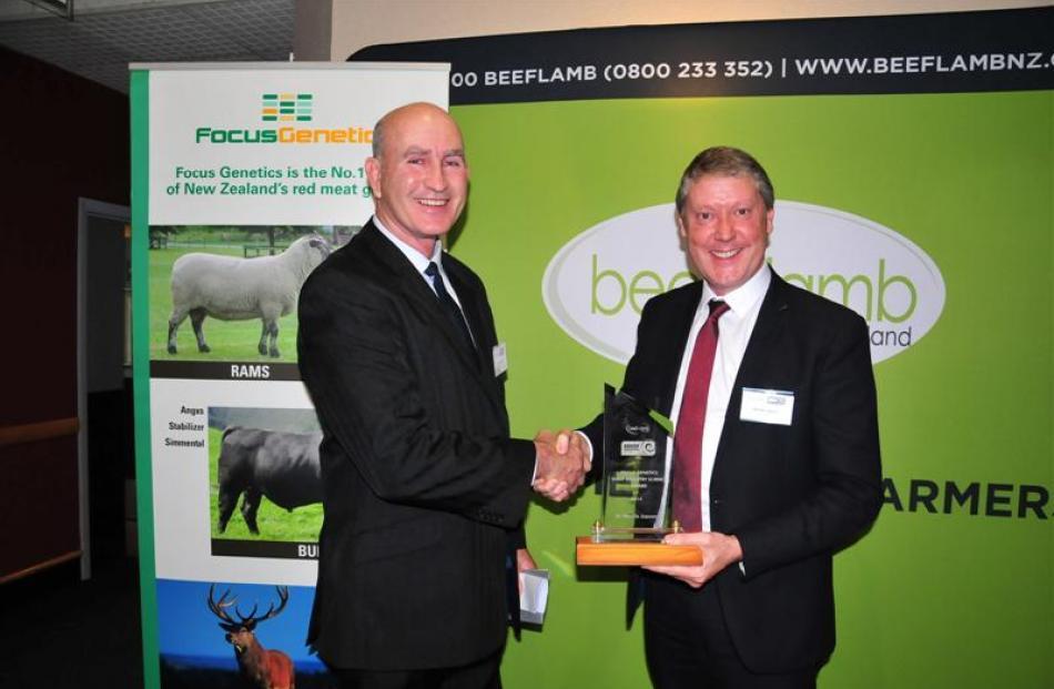 Dr Richard Lee (left), of Focus Genetics, presents AbacusBio managing director Neville Jopson...