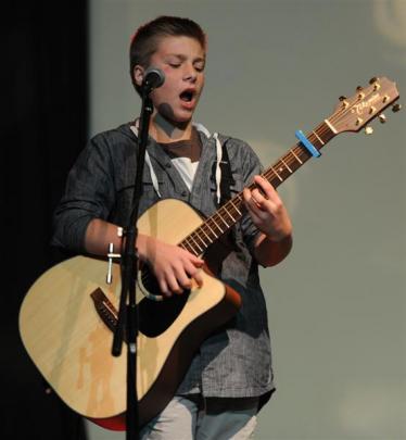 Kaleb Reid (13) displays his skills on guitar.