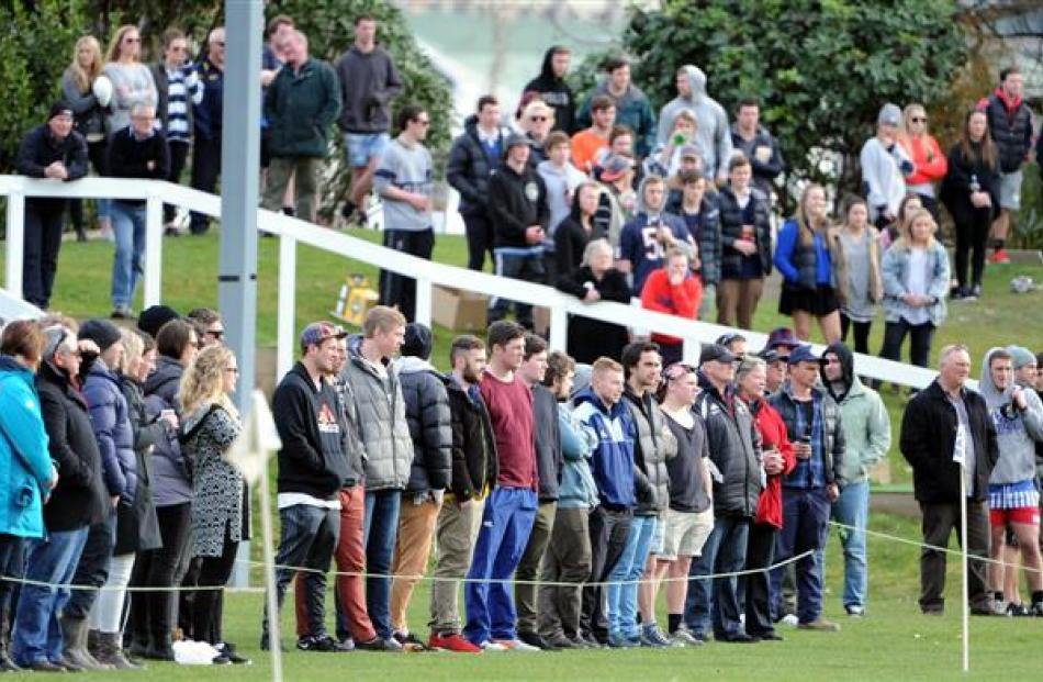 A large crowd watches the action at the University Oval on Saturday.