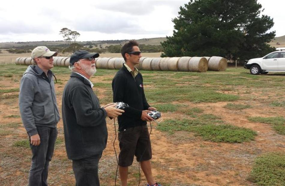 DroneMetrex representative  Ben Neale (left) watches as the company  Dave Whittle (centre) and...