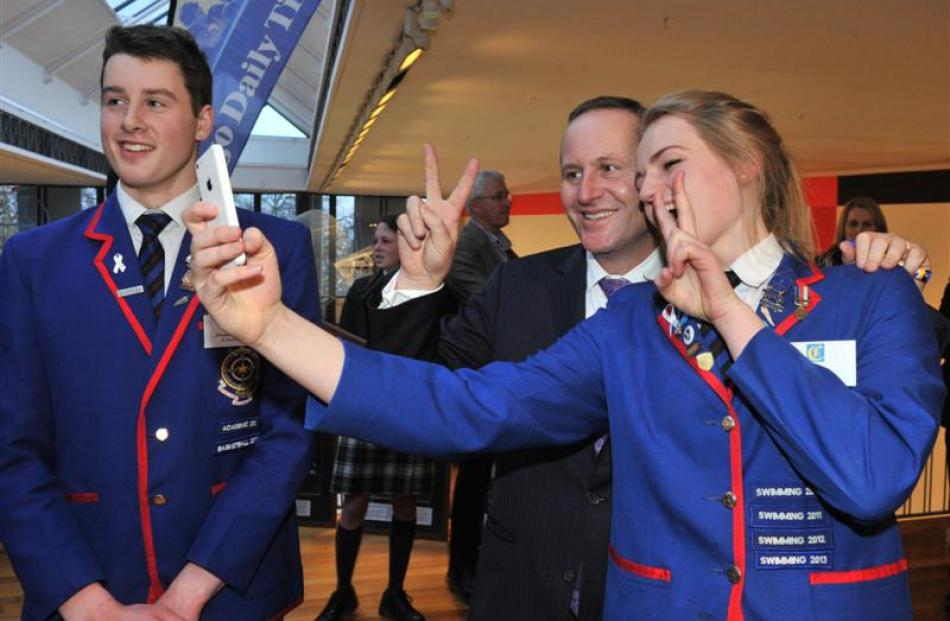 Mr Key strikes o pose with St Kevin's College pupils Christopher Kearney and Isobel Ryan. Photo...