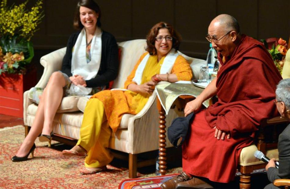 Dunedin city councillor Jinty MacTavish (left) and former mayor Sukhi Turner listen to the Dalai...