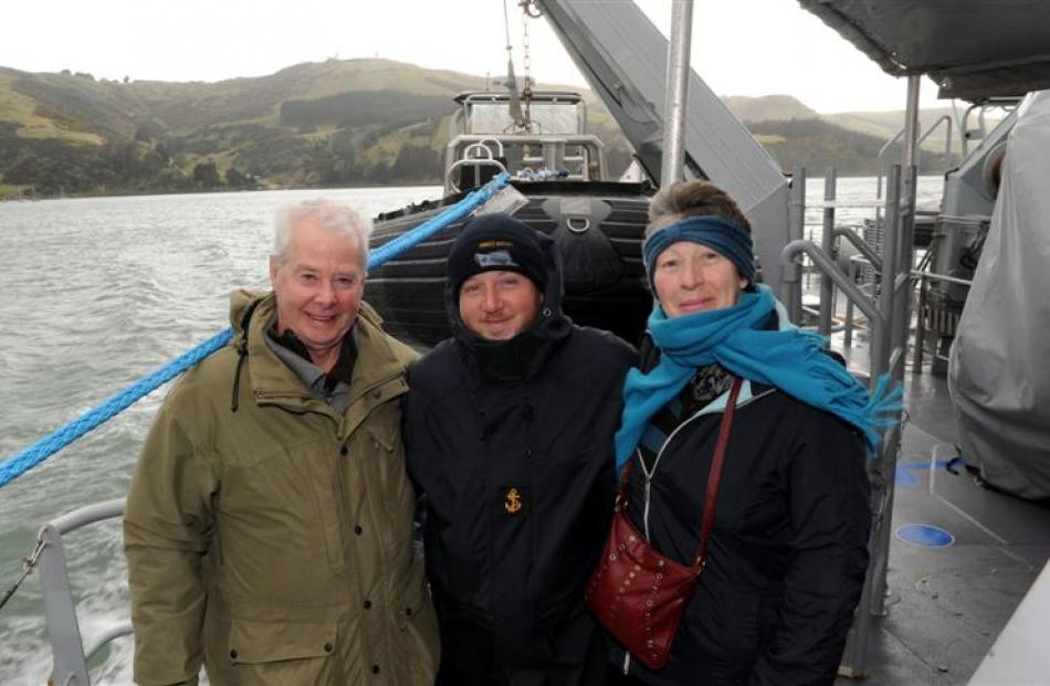 Leading Seaman Combat Specialist Konrad Cook (centre) shows his parents Ernie Cook and Annemarie...