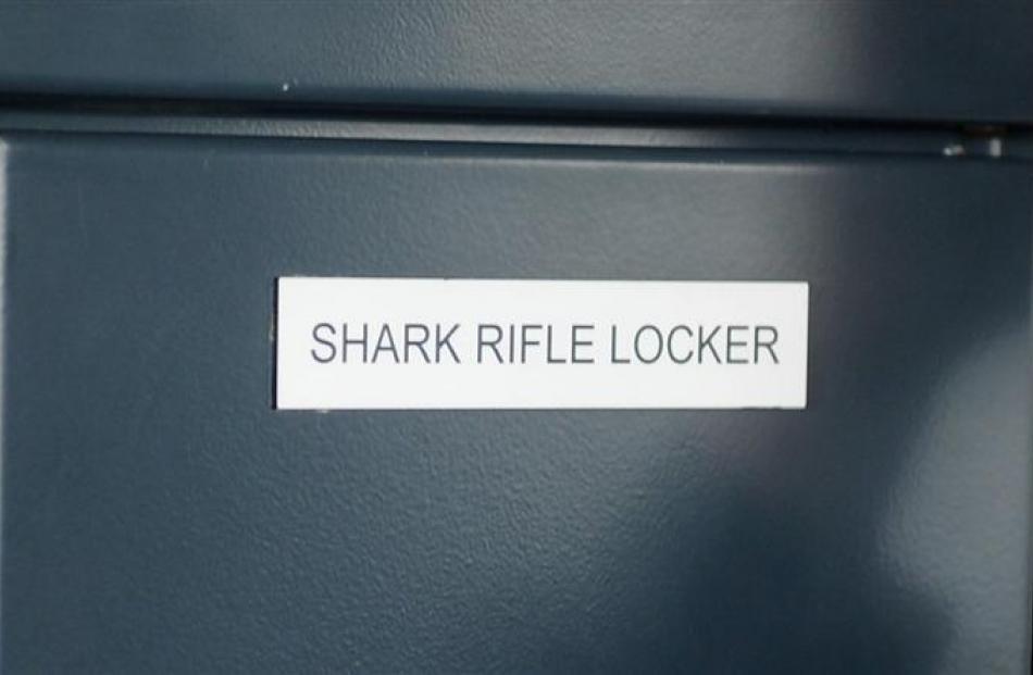 The ship's shark rifle is kept on the bridge.