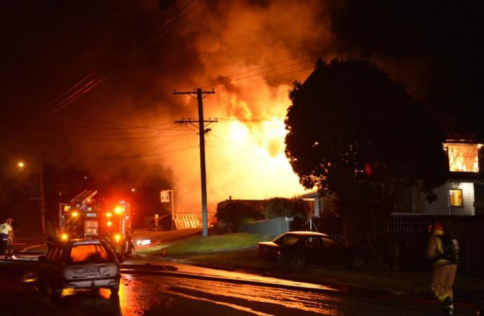 Flames pour from an Ocean Grove house destroyed in a fire last night.