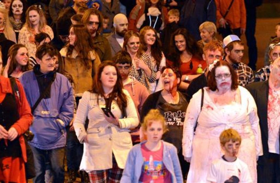 Zombies shuffle along Lower Stuart St in Dunedin.