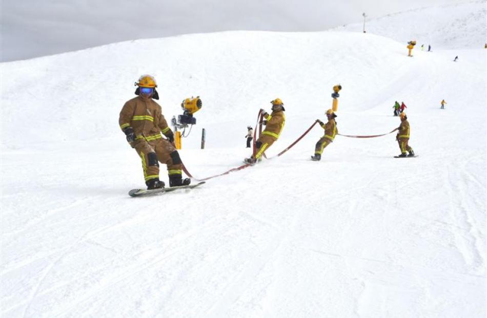 firefighters_prove_hose_the_best_for_charity_53f715c5d2.JPG