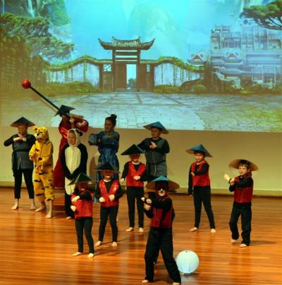 Kung Fu Fighting (below) during the Abbotsford School Musical at Otago Boys' High School on...