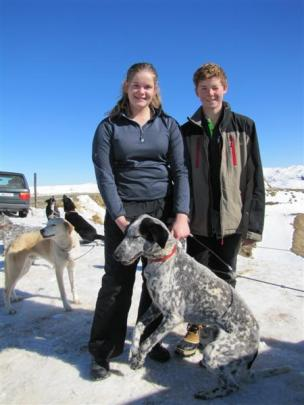 Jess Winther (15) and Josh Winther (13), of Melbourne, get their borrowed sled-dog team ready to...