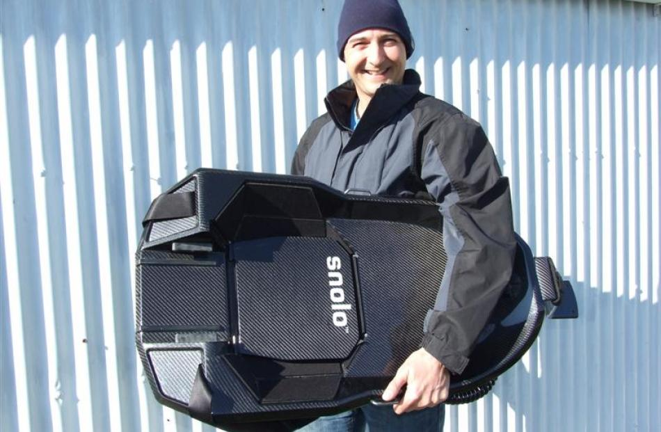 Snolo Sleds founder Sean Boyd with one of his high-performance sleds. Photo by Lynda van Kempen.