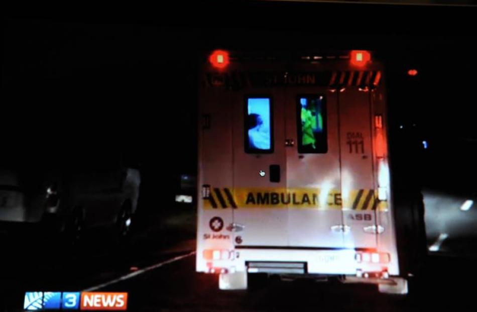 A patient is treated in an ambulance after an explosion in Dukes Rd, Mosgiel. Photo by 3 News.
