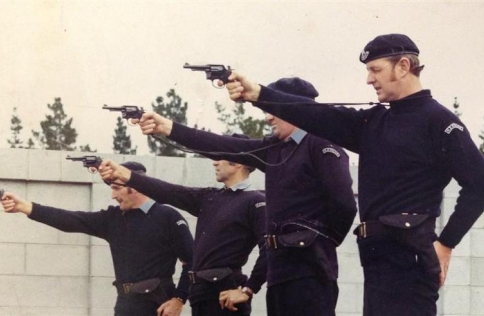 Members of the Dunedin AOS practise using pistols circa 1970.