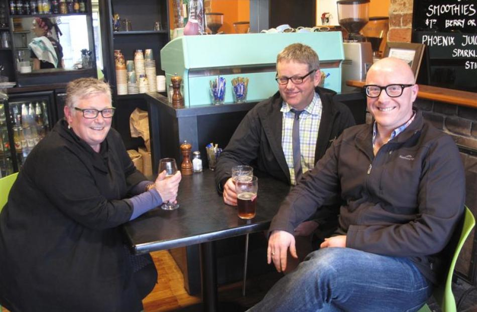 Friends Bridget Schaumann, Duncan McLean (centre) and Stewart Tagg enjoy a drink in St Clair.