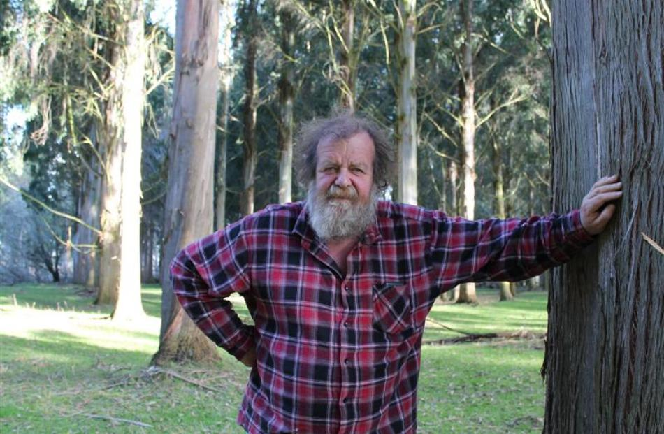 Graham Milligan on his Northern Southland farm among his eucalypt trees.