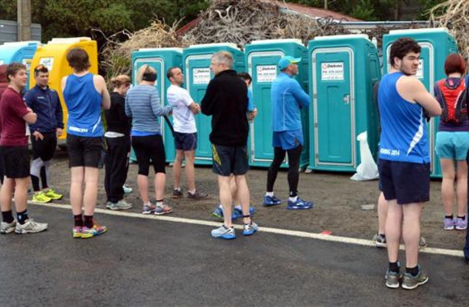 Nervous competitors queue before the start of the marathon yesterday.