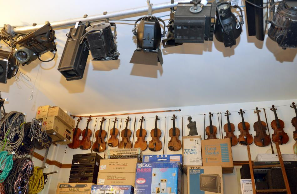 A storage area under the house holds lighting and sound systems as well as the violins that Lee...