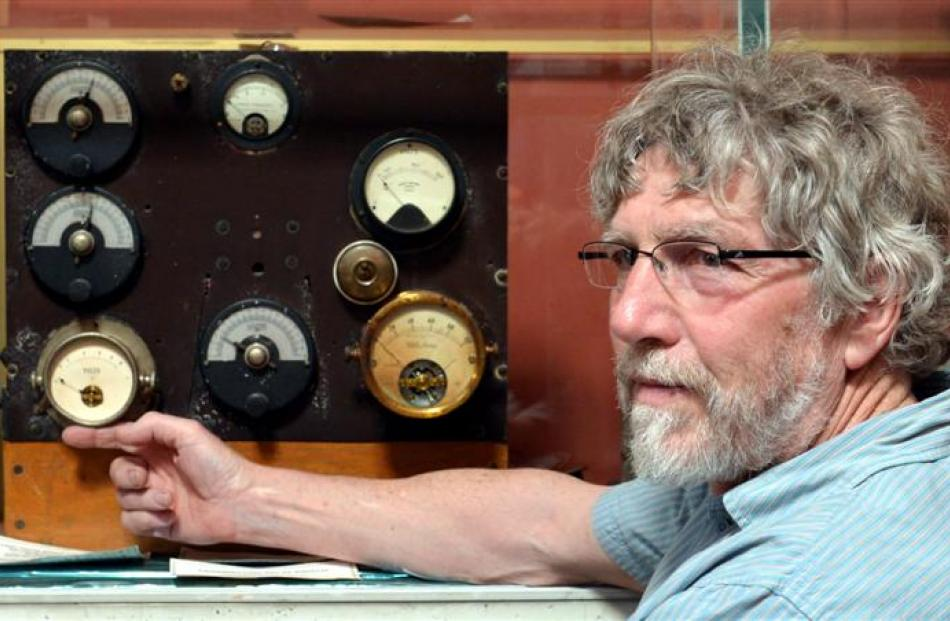 Dunedin radio operator Mike McAlevey with the home-made radio transmitter used to make the first...