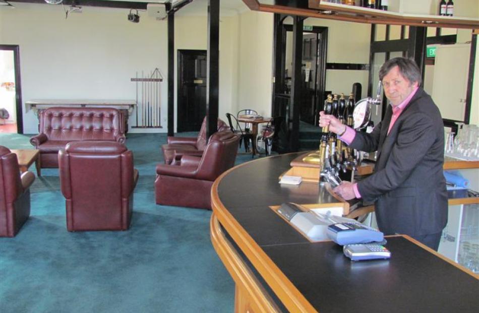North Otago Club president Peter Garvan at the bar built by member Dick de Geest when the club...