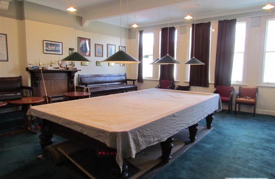 The  club's billiard room will remain with its full-sized slate table and photographs of early...