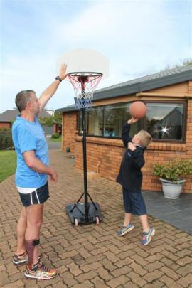 Brian Cowie shoots a few hoops with his son Nick (7) at their Invercargill home.