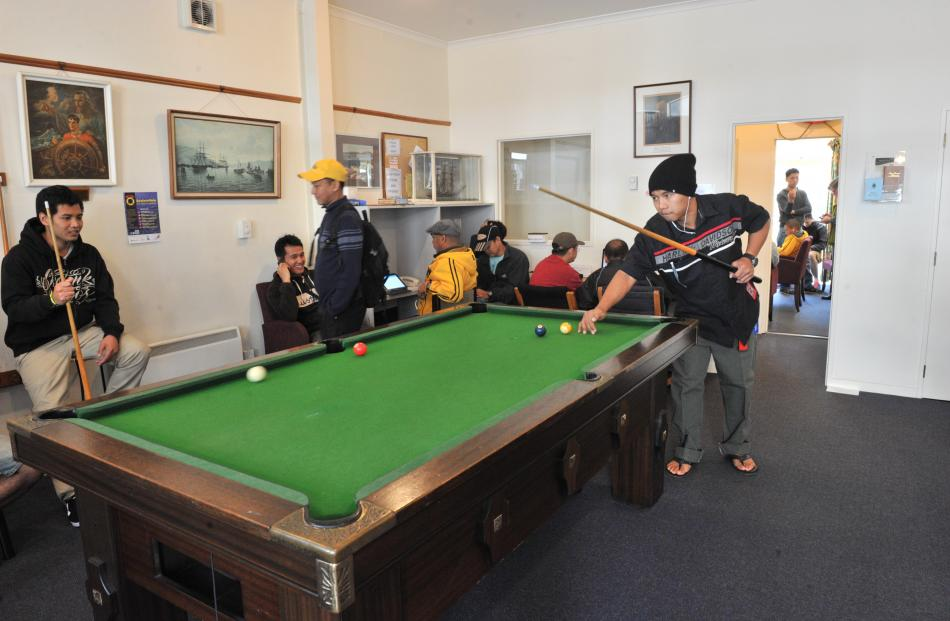 rew from the Sea Princess use the pool table and the internet at the Seafarers Centre.