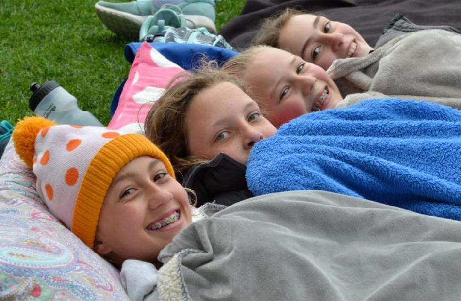 Keeping warm are (from left) Meg Sycamore (13), Millie Wright (13), Liv Preston (12) and Lucy...