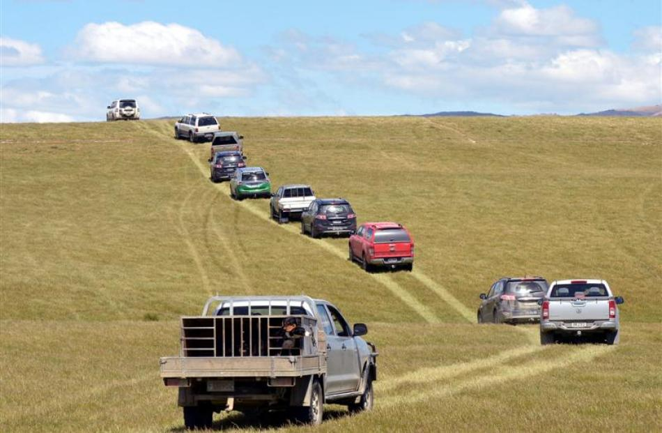 Vehicles wend their way through the Lindsay family's farm.
