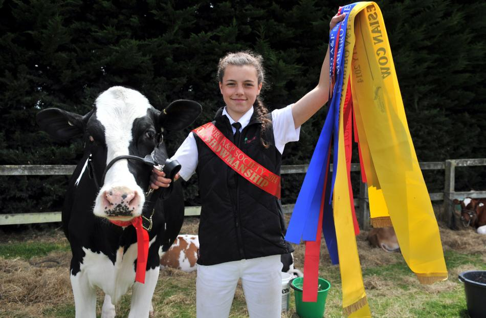 Lorna Button (14) of Port Molyneux, near Kaka Point holds some of the ribbons she was awarded at...