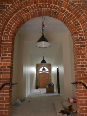 An original brick archway has been restored.