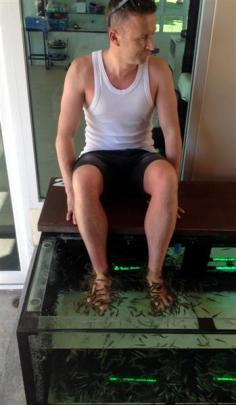 Hamish McNeilly gets the dead skin nibbled off his feet while on holiday in Thailand in November.