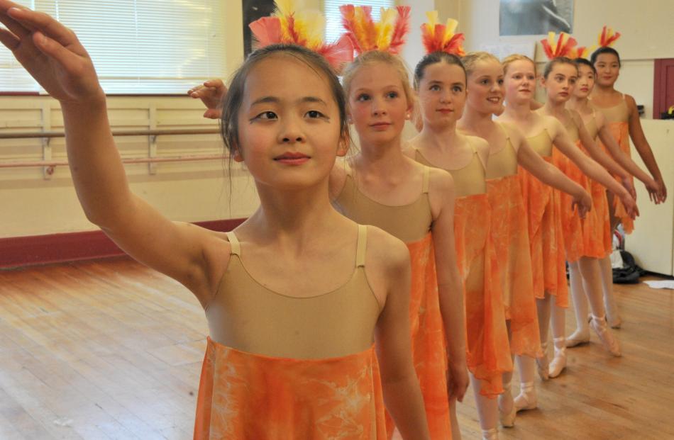 Dancers (from left) Ruth Huang (12), Lauren Buttery (12), Summer Paulin (11), Jessica Larkins (12...