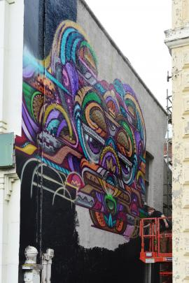 A mural of ''Nameless Lane'', off Police St.  The artist is BeFree of Melbourne. Photo by Peter...