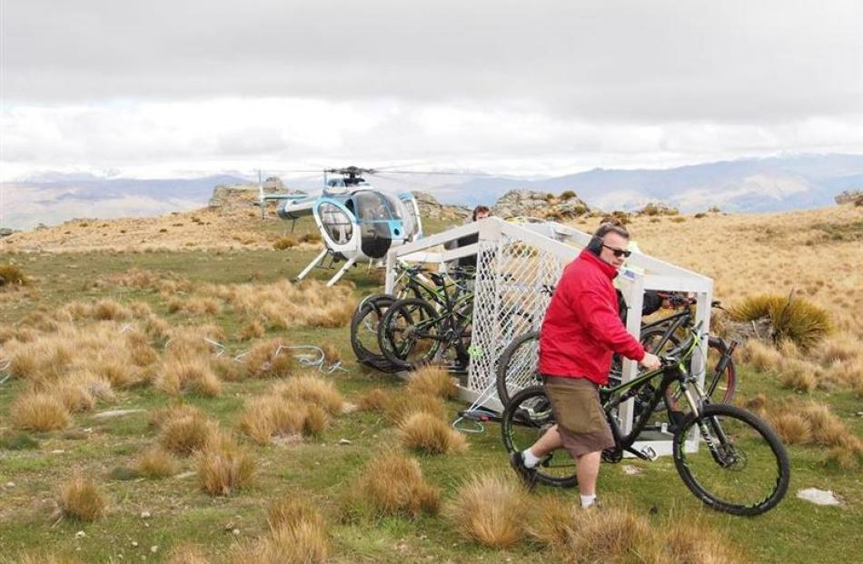 Peter Donaldson wheels his bike from the transport cage.