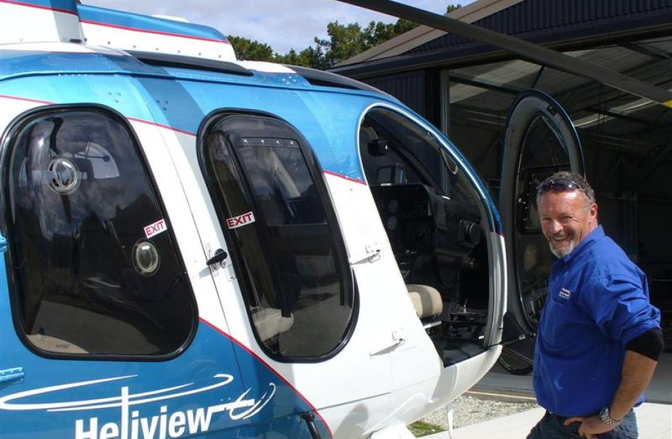 Richard Foales, of Heliview, with his  MD600N helicopter.