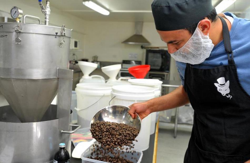 Arjun Haszard at work in his kitchen in Glasgow St, Dunedin.