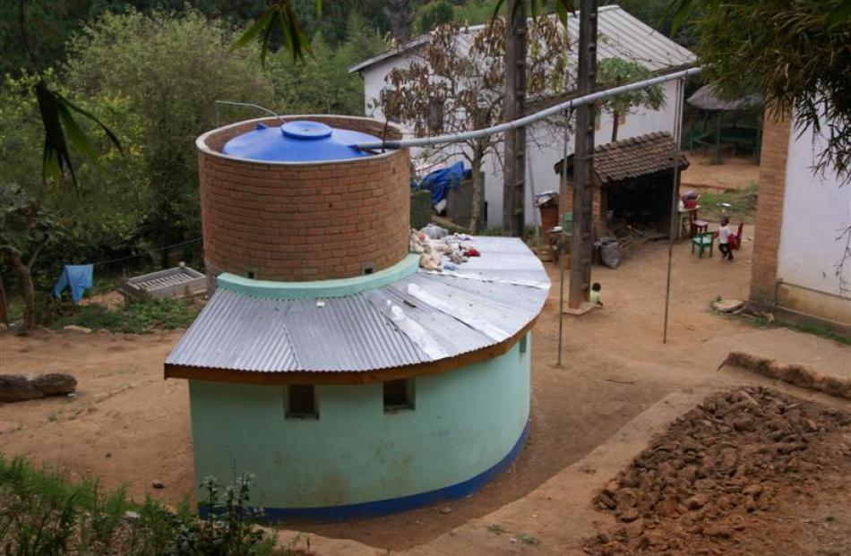Shower block using stored rain water.