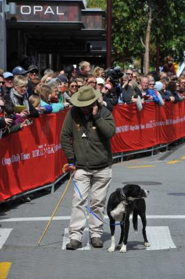 John Harvey, and his dog Bob, from Martinborough, await the mob on Beach St.