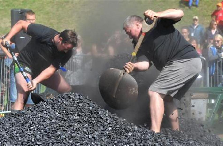 Royce Green (left) and Brian Coghlan compete in the coal shovelling competition.