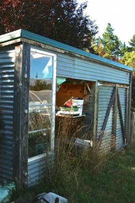 This garden shed was clad with recycled iron and windows.