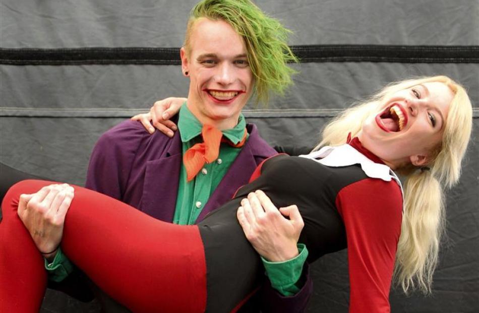 Samuel Rillstone, as The Joker, holds Victoria Ransom, as Harley Quinn.
