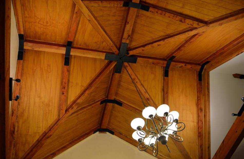 A glass ceiling was planned for the dining area but budget constraints saw it made in macrocarpa...