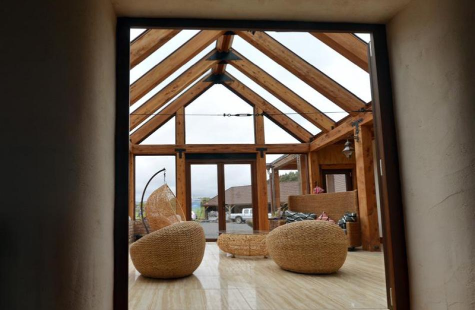 The conservatory's large windows and skylights draw heat into the building while the thick straw...