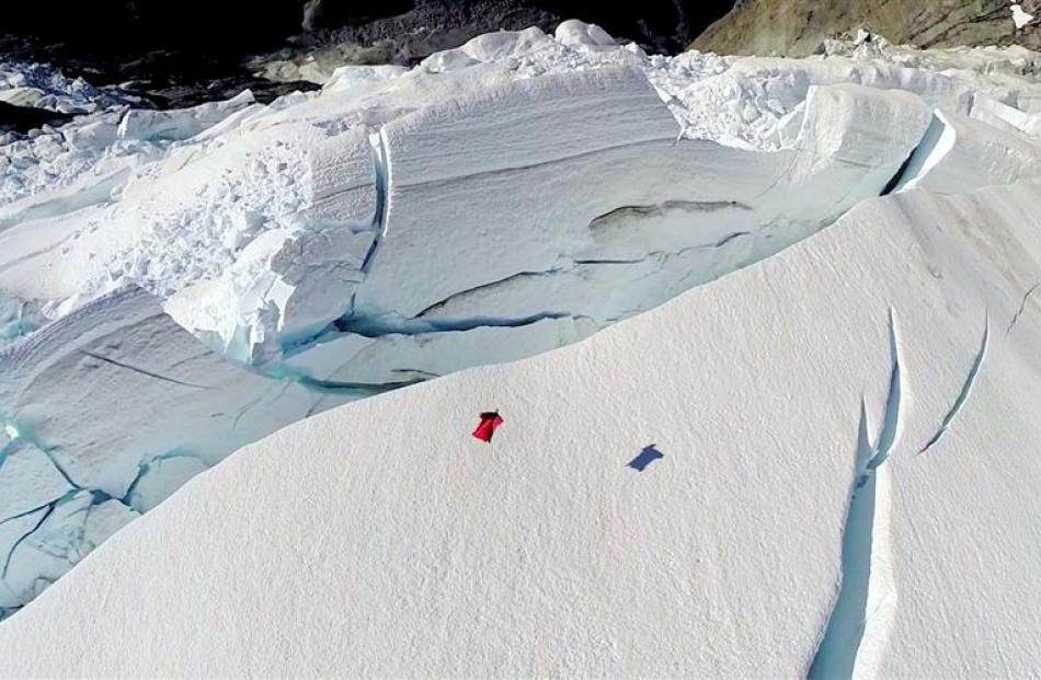 David Walden  flies low over the Rob Roy Glacier, chasing his shadow.